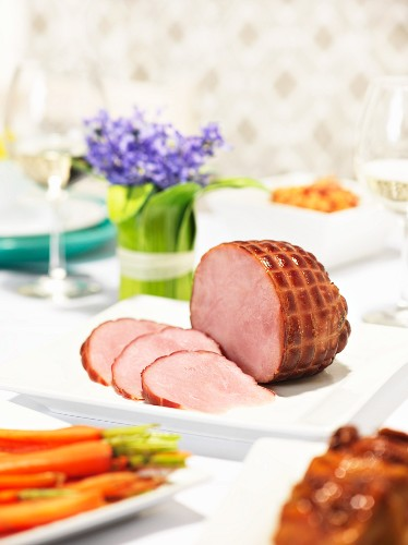 Roast ham with carrots for Easter