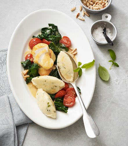 Basil dumplings with fried cod and vegetables