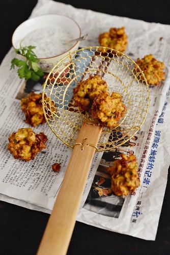 Cauliflower pakoras with coriander and mint yoghurt (Singapore)
