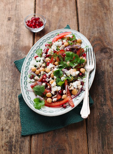 Chickpea salad with peppers, feta cheese and pomegranate seeds