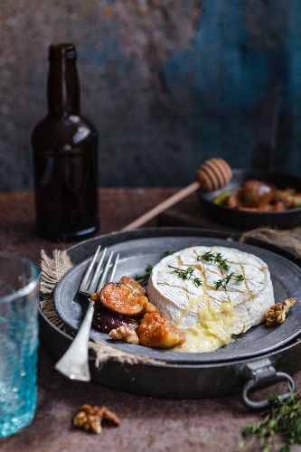 Baked Camembert with figs on a metal plate