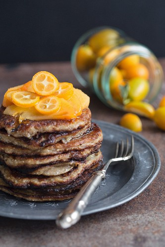 Chia pancakes with kumquat and sharon fruits