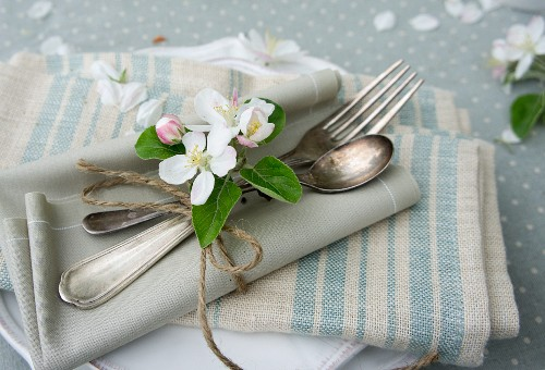Place setting with apple blossom and napkins