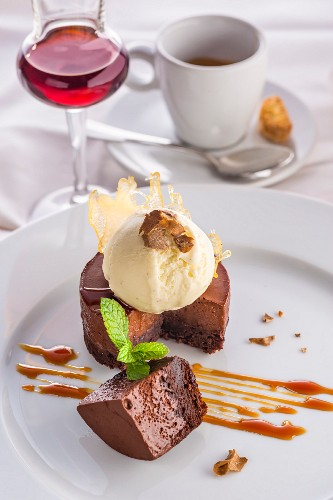 Chocolate cake with white truffle ice cream and caramel sauce