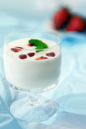 Kefir with strawberries and mint in a dessert glass