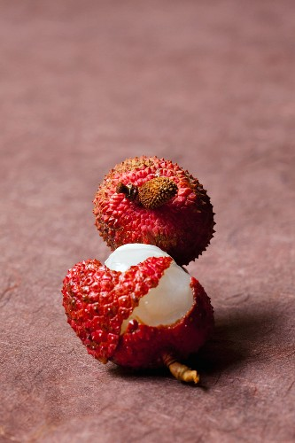 Two lychees, one opened