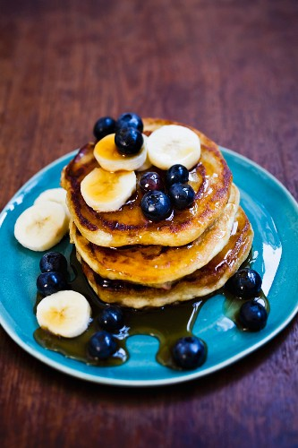 Pancakes with berries, blueberries and maple syrup
