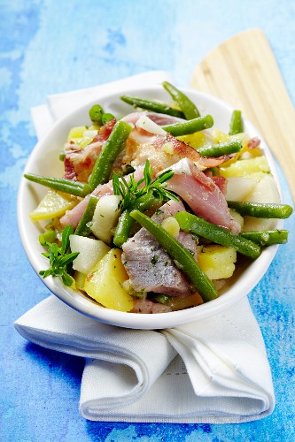 A smoked herring salad with pears, green beans and bacon