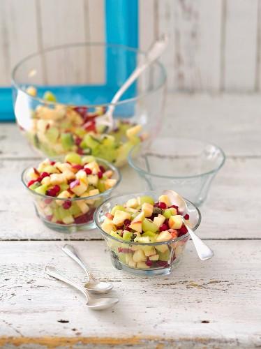 Macedonian fruit salad with apple, kiwi, banana, redcurrants and grapes
