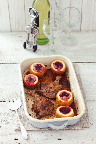 Roasted duck legs with apples filled with cranberries