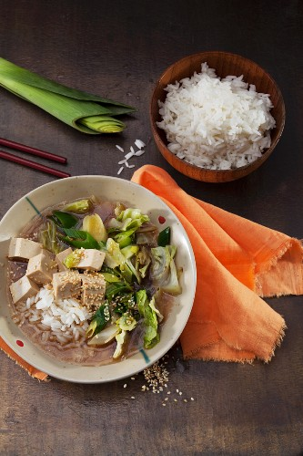 Vegan miso soup with tofu, pointed cabbage and roasted sesame seeds