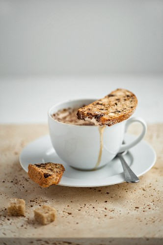 Biscotti on a coffee cup