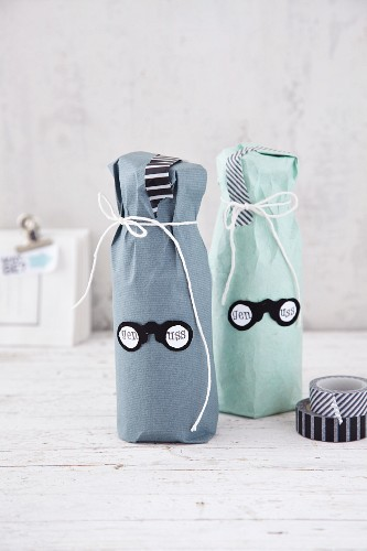 Bottles wrapped in paper as a gift