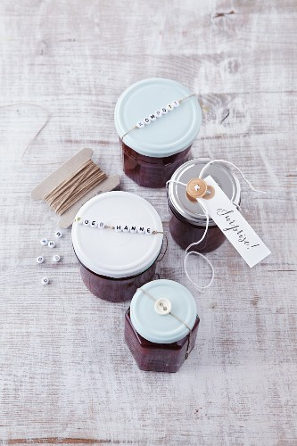 Jars of jam decorated with letter beads