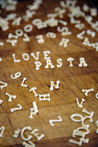 The words Love and Pasta spelt with alphabet pasta