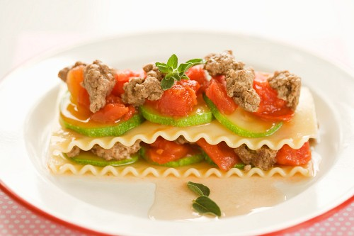 An open lasagne with minced beef, tomatoes and courgette