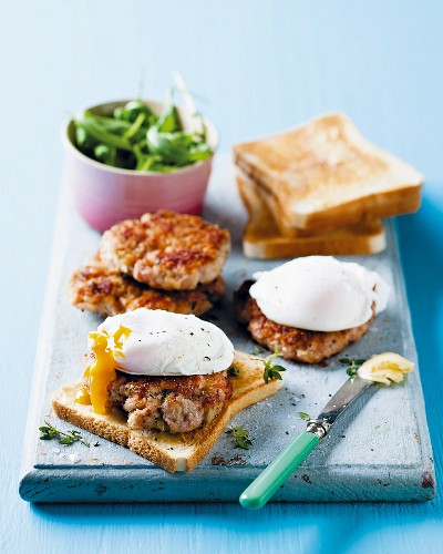 Sausage meat burgers on toast with poached eggs