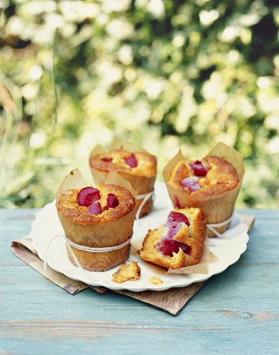 Plum muffins on a garden table