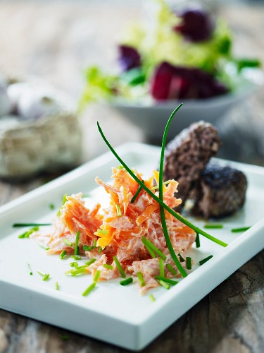 Carrot salad with yoghurt sauce and chives served with beef meatballs