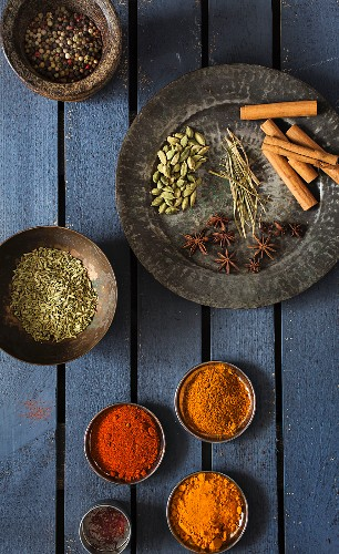 Various spices in bowls and on a plate