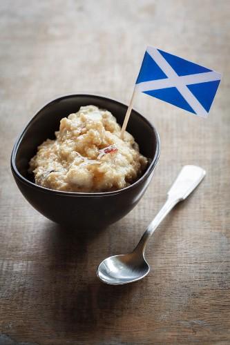 Porridge in bowl with a Scottish flag