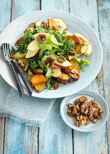 Apple salad with vegetables and walnuts