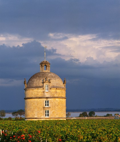 The pigeonnier of Château Latour with the Gironde estuary beyond. Pauillac, Gironde, France. [Bordeaux / Médoc]