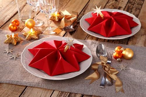 Folded napkins as festive table decorations
