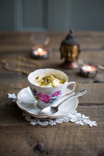 Mango kulfi (Indian ice cream) with pistachios