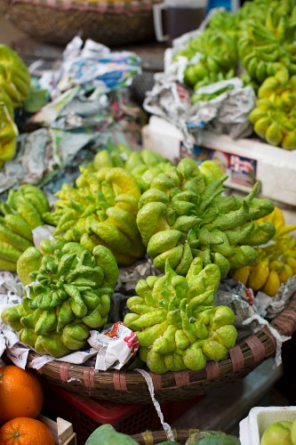Buddha's fingers citrus fruits at a market in Hanoi, Vietnam