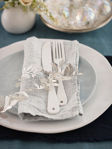 A place setting on a Christmas dining table
