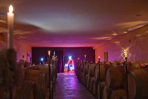 Neon artwork and subtle lighting in the barrel cellar at Chateau Ducru-Beaucaillou (Bordeaux, France)