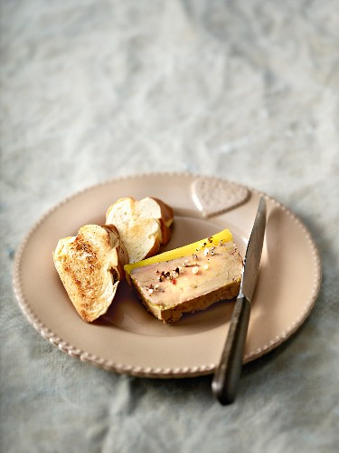A slice of goose liver terrine with spices and brioche
