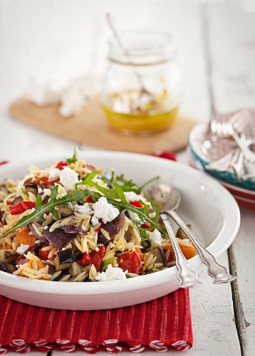 Noodle rice salad with vegetables and ricotta