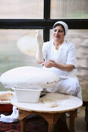 Unleavened bread being made in a bakery in Lebanon