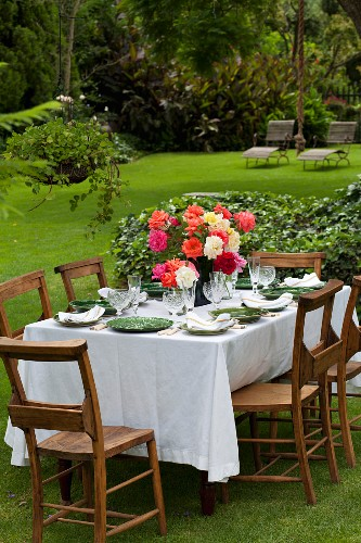 A summery table laid in a garden