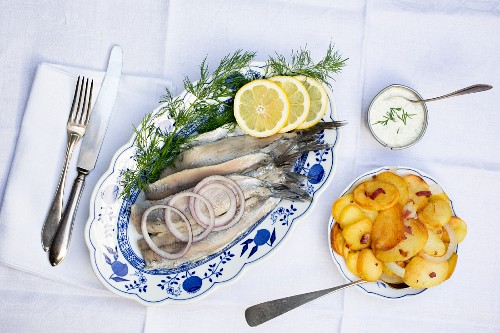 Soused herring fillets with fried potatoes and remoulade