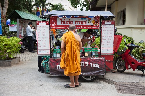 A Buddhist monk at a fast food stall
