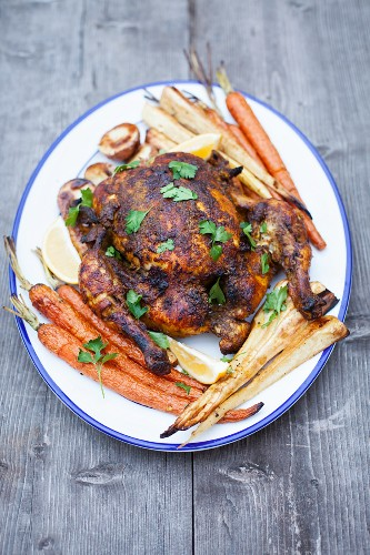 Empire chicken (spicy roast chicken) with roast vegetables