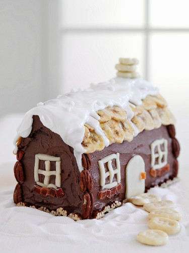 A gingerbread house decorated with nuts and dried fruit