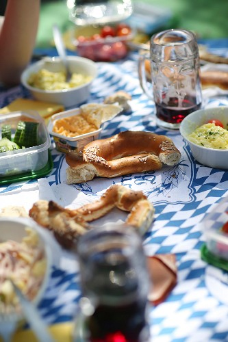 Supper with tankards of beer on a beer garden table (Bavaria, Germany)