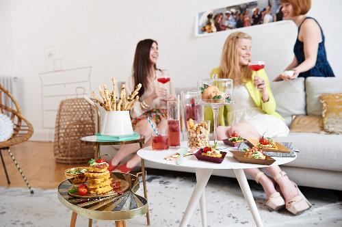 Women drinking virgin grapefruit margaritas at a party