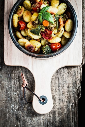 Gnocchi with vegetables and basil (seen from above)