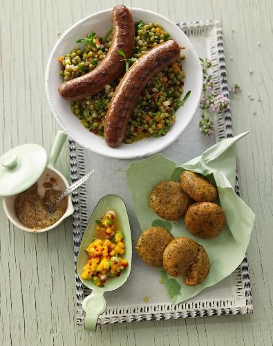 Lentil and parsley falafel with the raw mango chutney, roasted Merguez sausage with wild garlic mustard and a mung bean salad