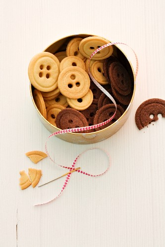 Light and dark button biscuits in a biscuit tin