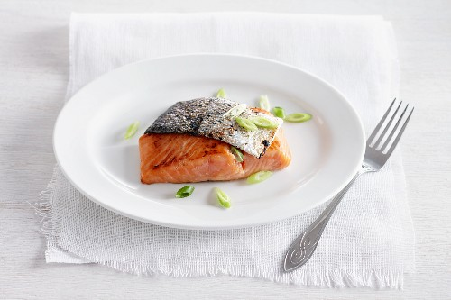 Salmon with fried skin and spring onions