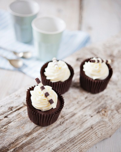 Chocolate cupcakes with chocolate cigarillos