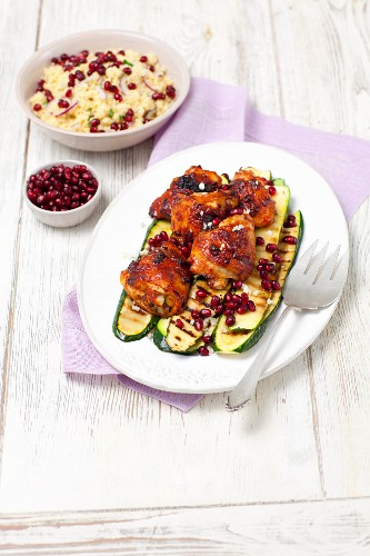 Grilled chicken thighs and courgette with a couscous and pomegranate salad