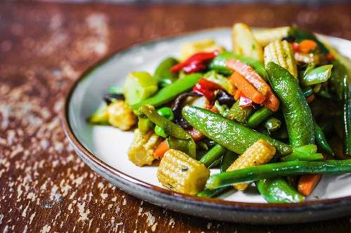 Fried vegetables with baby corn cobs