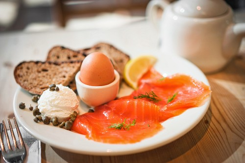 A healthy breakfast with smoked salmon and a soft boiled egg